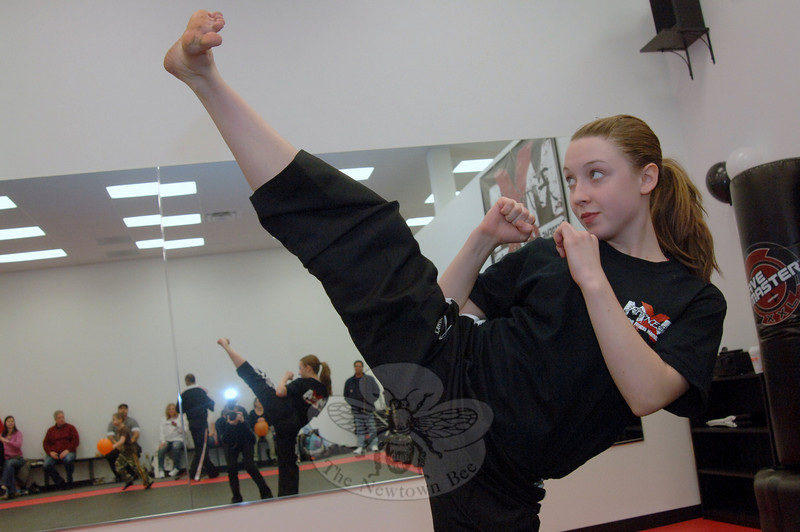 Student Kristen Dakin works through her routine on February 5 during the grand opening of Extreme Fitness & Martial Arts, a new business in Plaza South.  (Bobowick photo)