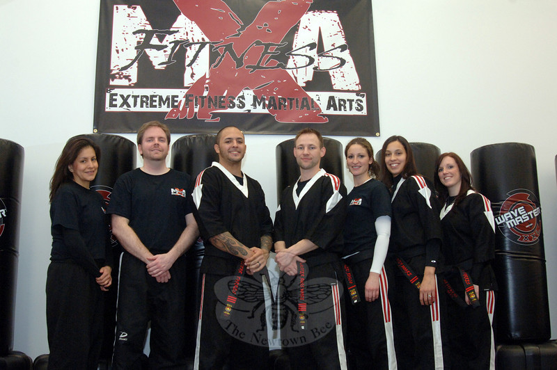 Marcela Crowley, Greg Crowley, Victor Torres, Russ Moore, Meri Rosco, Cindy Moore, and Katlen Torres were all at the grand opening of Extreme Fitness & Martial Arts.  (Bobowick photo)
