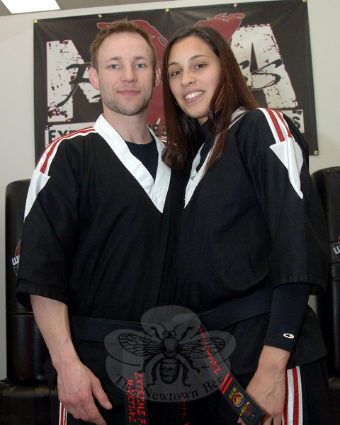 Russ and Cindy Moore, during the February 5 grand opening of Extreme Fitness & Martial Arts, a new business in Plaza South.  (Bobowick photo)