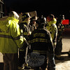 Botsford Fire Rescue Chief Wayne Ciaccia on the right in the yellow coat, confers with some of his firefighters following the building collapse.  (Gorosko photo)