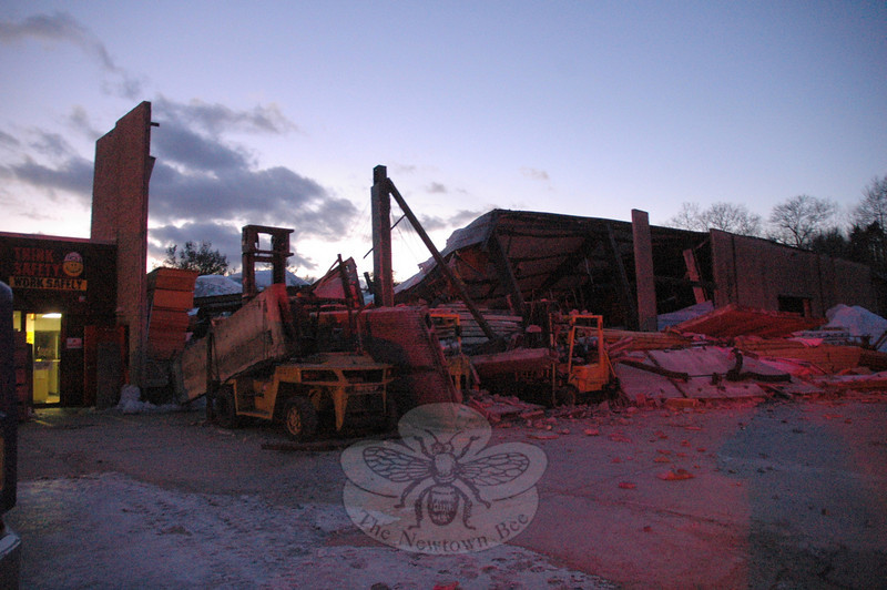 Early Tuesday evening, under the weight of accumulated snow on its roof, a large warehouse collapsed at the BlueLinx Corporation's building materials distribution center at 201 South Main Street. It was the third large structure to have collapsed at the site since February 1.  (Gorosko photo)