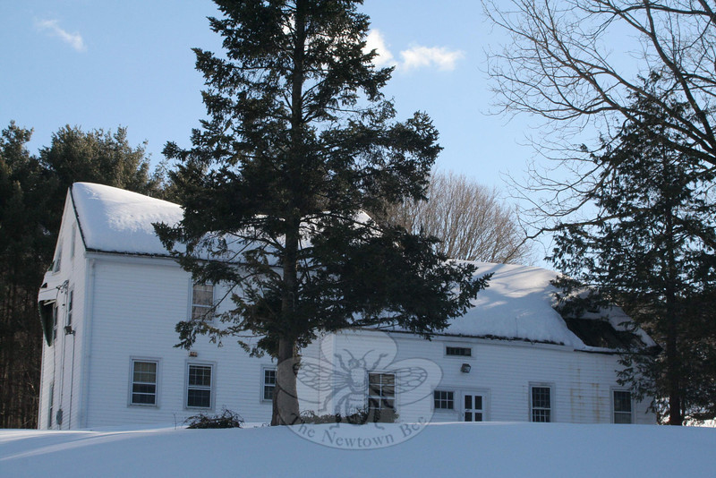 A look at the north-facing side of the farmhouse at 121 Wasserman Way on February 8  showed the full collapse of the western section of the building's westernmost roof.  (Hicks photo)