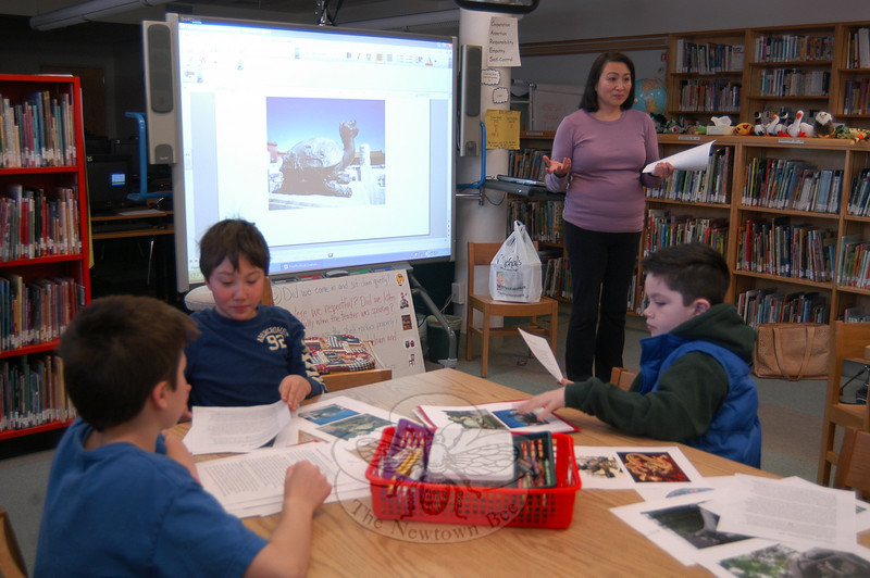 Sandy Hook School parent volunteer Wan Huffman taught students about mythological animals from Chinese culture on Friday, February 4.  (Hallabeck photo)
