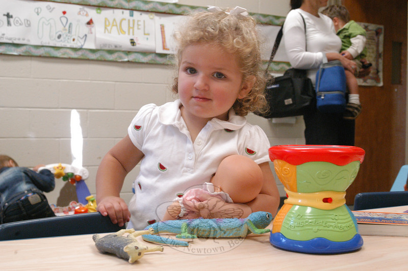 Two-year-olds started school on Monday, September 20, for the first time at Trinity Day School. The program is new this year. Like her fellow preschoolers, Maggie Mattera went straight for the toys situated around her new classroom.  (Hallabeck photo)