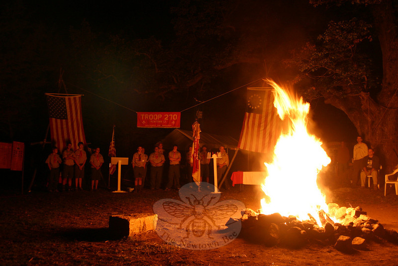 About three dozen members of Boy Scout Troop 270 participated in the troop's annual flag retirement ceremony on September 18. The troop formally retired about 40 flags this year, showing dignity and respect to flags of all sizes that were torn, faded, soiled, or otherwise in need of proper incineration.  (Hicks photo)