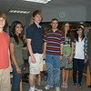 From left, Newtown High School seniors Drew Robinson, Ayesha Dholakia, Brian Reed, Matt Jensen, Miryam Wilson, and Amy Kung stand with NHS Principal Charles Dumais after being recognized as National Merit Scholarship Program Semifinalists. The NHS seniors are three of about 16,000 students nationwide who have earned this recognition, which represents less than one percent of high school seniors nationally. The students are now eligible for consideration for National Merit Scholarship awards. Students who go on to be recognized as National Merit Scholars will be among the top 2,500 students in the country.  (Hallabeck photo)