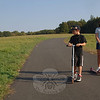 Newtown residents made the most of the clear skies and mild temperatures this week as one season changed into another. On the last day of summer, brother and sister Luke and Heather Azzarito rode their scooters down the smooth asphalt trail traversing High Meadow at the Fairfield Hills campus.  (Bobowick photo)