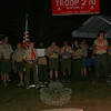 Matt Cosgrove approaches the campfire with a flag to be retired during a formal ceremony done by Boy Scout Troop 270 last weekend. Also participating in the ceremony, from left, were Doug Main, Matt Rosa, Thomas Long, Nikhil Trivedi, Steve Anderau, Daniel Ansari, Nick Mitsos, Brandon Unger, Michael Hubbard and Felix Summ.  (Hicks photo)