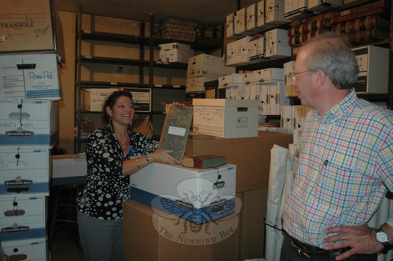 Town Clerk Debbie Aurelia and document preservation expert Peter Bartucca spent time at the Edmond Town Hall vault on Monday, September 20, planning for the moving and preservation of historic town records from the existing location to the new vault at Newtown's Municipal Center at Fairfield Hills. The Charter Revision Commission was urged last week to make the town clerk's position an appointed one. The town clerk stands for election under the current charter.  (Voket photo)