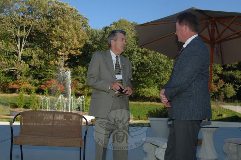 Tom Hill of Tom Hill Realty and Investment, LLC, left, speaks with Jeff Ryer of Ryer and Associates.  (Bobowick photo)