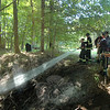 Members of Botsford Fire Rescue including Dani Brackett on point, wet down a wooded glen behind 1 Orchard Hill Road on September 16 following a small brushfire. All local fire companies have been on heightened watch in recent days as the long spell of dry weather, low humidity and gusty breezes have created optimal conditions for brush fires.  (Voket photo)