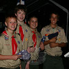 Sam Boland, Jack Benedict, Doug Main, and Matt Rosa, from left, wait for the flag retirement ceremony to begin last weekend. The boys, members of Boy Scout Troop 270, were among three dozen Scouts and leaders who also camped overnight at Cherry Grove Farm.  (Hicks photo)