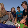 "With autumn's arrival interrupting September's flow of warm days this week, students and friends enjoyed the last day of summer on Wednesday, September 22. Sitting together on their ""blanket of sorrow"" were four girls who had minor injuries and could only watch as their cross country teammates ran the trails. From left are Alyse Brautigam, Sami Chanko, Randi Jackson, and Dani Villa.   (Bobowick photo)"