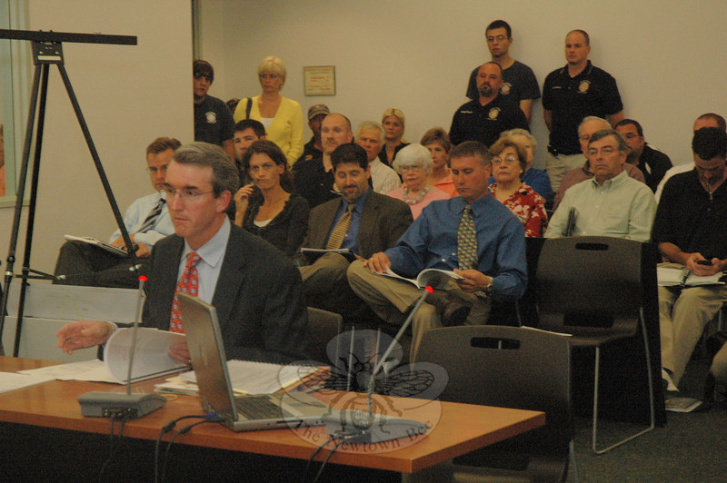 Attorney Christopher Smith, foreground, representing Newtown Hook & Ladder Company, #1, speaks at a heavily attended September 22 Inland Wetlands Commission (IWC) public hearing on the volunteer fire company's proposal to construct a new firehouse at 12 Sugar Street (Route 302). The proposal drew both support and opposition at the session.  (Gorosko photo)