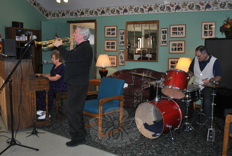 """From left, Ethel Kaufman on piano, Bucky Milam on trumpet, and Jeremy Alston on drums were at Newtown Senior Center on Tuesday, September 21, to present """"Music from the Heart,"""" a medley of old-fashioned favorite tunes. Mr Milam, who has performed with notables such as the late Skitch Henderson, Glenn Miller, and Jimmy Dorsey, encouraged the audience to sing along during the program, leading off with """"Blue Skies"""" by Irving Berlin.  (Crevier photo)"""