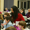 Adele Whitlock (seated, with fingers crossed and hands clasped) waits while Bernadette Queenan checks her numbers during Family Bingo Night on Friday, February 11, in the St Rose Gathering Hall. The St Rose Home School Association sponsored the event, which drew more than 100 people of all ages for a few hours of mid-winter fun. Adele, who was at the event with a large contingent of her family, was one of the very lucky winners to go home with a cash prize Friday night. One more Family Bingo Night is scheduled for April 8.  (Hicks photo)