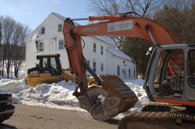 Demolition crews from AAIS of West Haven cleared snow around the old, state-owned farmhouse at 121 Wasserman Way, preparing to take it down only days after heavy snow crumpled the building's roof.  (Bobowick photo)