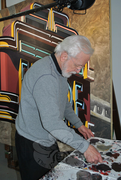 "Robert Cottingham mixes paint in his barn studio for what may be his final oil painting of the Empire Theater marquee, seen in part behind him. ""The Empire Theater"" series will be on exhibit in New York City beginning February 24, but this large painting may not end up in that collection.  (Crevier photo)"