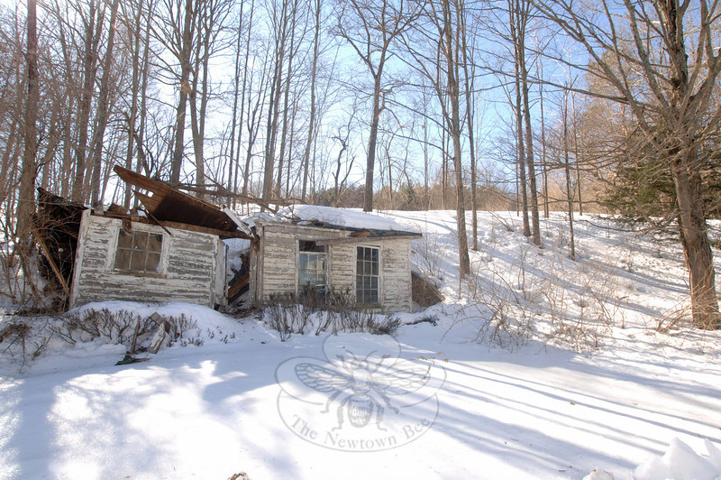 An outbuilding behind the farmhouse at 94 Wasserman Way is also collapsing.  (Bobowick photo)