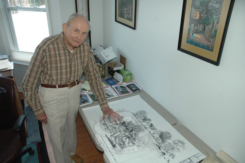 Charles Speidel of Hawleyville reviews the architectural plans for his distinctive 7 Taunton Lane house, which was destroyed by fire early on the morning of January 28. Mr Speidel plans to rebuild a house at the site that recreates the appearance of the destroyed building.  (Gorosko photo)