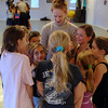 Pilobolus instructor Annika Sheaff  gathers students into a huddle as she smiles at their fidgeting in a tight group. Ms Sheaff was visiting The Graceful Planet, the Sandy Hook mov-ing arts center, as part of a three-session workshop that ran February 2-4.  (Bobowick photo)