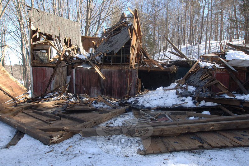 A multistory barn at 94 Wasserman Way collapsed in past days due to snow, ice, and disrepair. The barn and farmhouse on that site are now slated for demolition.  (Bobowick photo)
