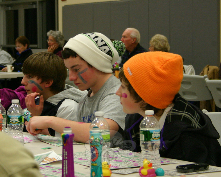 Gamers of all ages turned up for Family Bingo Night on February 11, including these three who put on their game faces.  (Hicks photo)