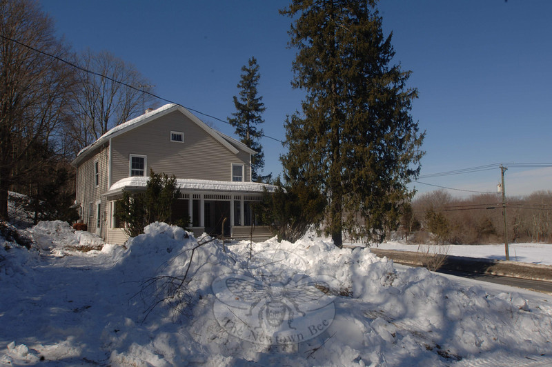 This farmhouse, at 94 Wasserman Way, is marked for demolition in coming days.  (Bobowick photo)