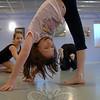Avi Bialik is upside down in a stretch.  (Bobowick photo)