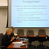 "First Selectman Pat Llodra, foreground, and Board of Education Chair Bill Hart teamed up to offer a town budget overview following the Board of Finance public hearing on February 17. Touting a ""significant increase in the degree of collaboration"" among town and school staff, Mrs Llodra said the combination of efforts from all involved will contribute to the success of the best-case proposal.  (Voket photo)"