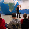 Sonja Robbins, a teacher with Earth Adventure, met Hawley Elementary School students in the school's gymnasium on Friday, February 11, for the second day the Earth Balloon was at the school. Ms Robbins first introduced students to the Earth and different concepts related to geography outside the balloon before bringing students inside to explore other topics.  (Hallabeck photo)