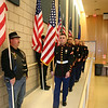 A United States Marine Corps Color Guard presented and, as seen above, retired the colors for Sean Decker's mural dedication ceremony. On the left, along the wall, are members of The Patriot Guard, who also participated in the special event.  (Hicks photo)