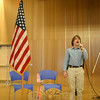 """Taylor Varga sang the national anthem Thursday afternoon during the ceremony to formally dedicate Sean Decker's mural """"Connecticut's Fallen Heroes.""""  (Hicks photo)"""
