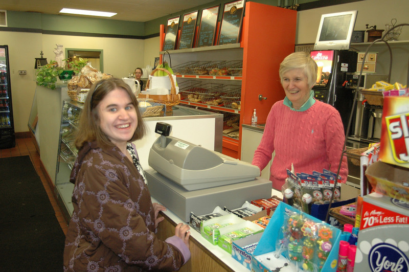 Owner Eunice Laverty, behind counter, waits on Kristen Palmer during a visit to Bagel Delight on Church Hill Road. As one of many local women-owned businesses, Ms Laverty said she supports a legislative review of how Connecticut qualifies and awards state contracts to women- and minority-owned businesses.  (Voket photo)