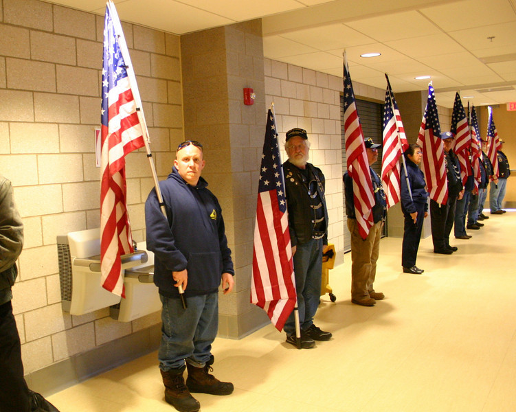 Members of The Patriot Guard silently lined two walls of the Newtown High School cafetorium during the mural dedication ceremony on Febraury 10.  (Hicks photo)