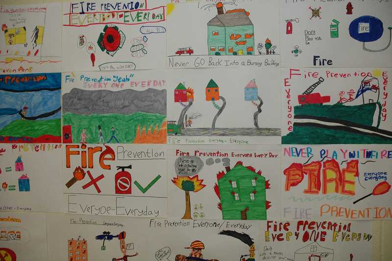 More than 440 Reed Intermediate School fifth grade students participated in the annual Fire Prevention Poster Contest, sponsored by the Newtown Fire Marshal's Office and intended to heighten the public's fire prevention awareness. Hundreds of posters made by the students are on display at the school; details of some of the posters are seen here.  (Gorosko photo)