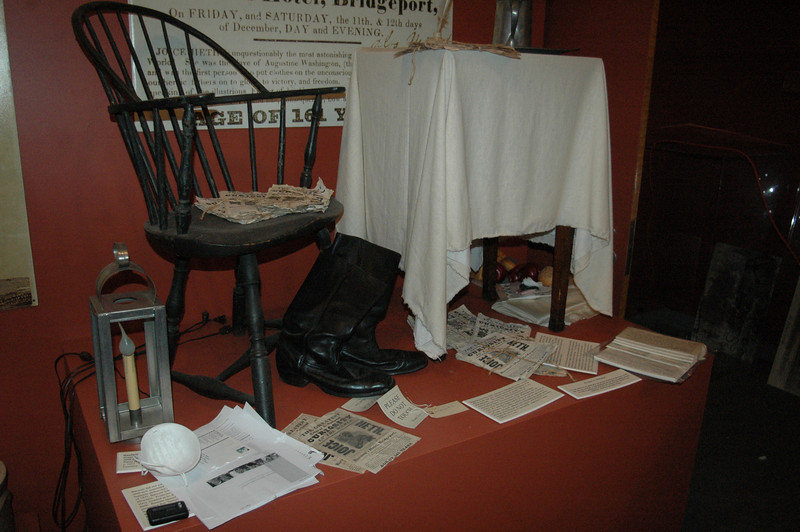 A protective mask and humidity gauge sit on a display of some of P.T. Barnum's possessions in one of the main exhibit halls compromised by an explosion of glass, wind and rain after a tornado struck the Bridgeport museum last summer. On February 25, plans were an-nounced to begin the renovation process to restore the state treasure to its former luster.  (Voket photo)