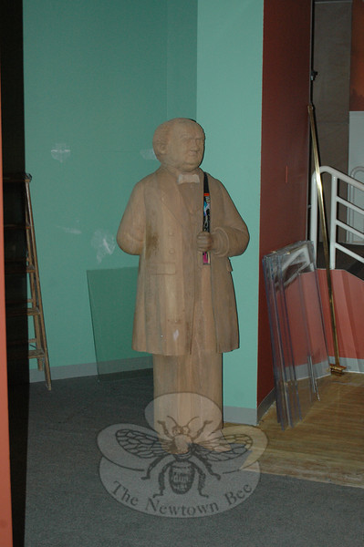 This wood carving of P.T. Barnum seems to be perplexed by the disheveled collectibles and exhibits that were damaged or displaced by wind and rain when a tornado struck Bridgeport's Barnum Museum on June 24, 2010.  (Voket photo)