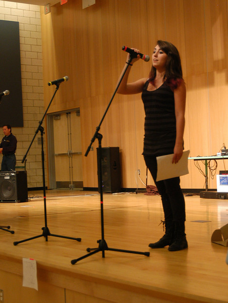 Newtown High School Junior Class Council member Mary Hamula introduced the start of the council's Battle of the Bands on Friday, February 25.  (Hallabeck photo)