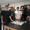 Newtown High School Chess Club Advisor Steve Mallory, left, stands with the club members who participated in the Danbury Area Scholastic Chess League tournament. From left are Tristan Villamil, Tim Barrett, Matt Pruner, Cole Baldino, Peter Kung, Alex Strzelecki, and Kai Hedin.  (Hallabeck photo)