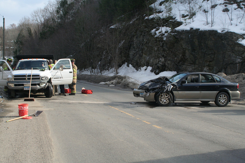At about 2:45 pm on March 2, motorist Lauren D'Amico, 24, of Blue Spruce Drive was driving a 2002 Subaru Legacy sedan northward on Pole Bridge Road, as Daniel Morrison, 33, of Southbury was driving a commercial 1999 Dodge Ram pickup truck westward on Bancroft Road, police said. The Subaru did not stop for a stop sign at the intersection of the two streets and then made a wide right turn, colliding with the Dodge. Both drivers and Dodge passenger Michelle Morrison, 35, of Southbury were transported by ambulance to Danbury Hospital for observation. Sandy Hook firefighters responded to the accident. Police gave D'Amico an infraction for failure to obey a stop sign.  (Hicks photo)