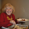 VNA board member Mae Schmidle is all smiles as she dishes up breakfast items served at the March 1 meeting. Maplewood of Newtown provided the hot breakfast for the VNA and guests.  (Crevier photo)