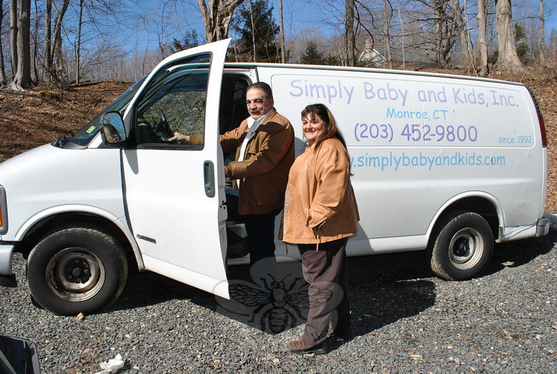 """Having a van to deliver larger items to Connecticut citizens in need is a """"blessing"""" says Make A Home founder Dan Telesco, shown here with partner Anita Pettengill. The 2001 Chevrolet van was a gift from Sand Hill Plaza business Simply Baby and Kids' owners Carie and Rich Turk, who said that they liked the idea of being able to recycle an unused vehicle for a good cause.  (Crevier photo)"""