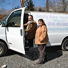 "Having a van to deliver larger items to Connecticut citizens in need is a ""blessing"" says Make A Home founder Dan Telesco, shown here with partner Anita Pettengill. The 2001 Chevrolet van was a gift from Sand Hill Plaza business Simply Baby and Kids' owners Carie and Rich Turk, who said that they liked the idea of being able to recycle an unused vehicle for a good cause.  (Crevier photo)"
