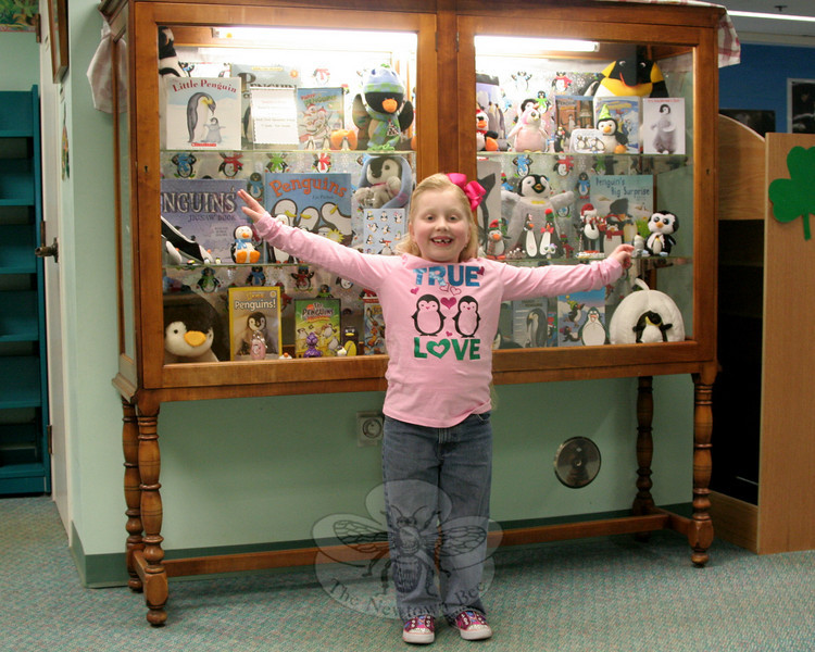 Mia Hochstetler has loaned the majority of her personal collection of penguin-themed items to C.H. Booth Library for its March exhibition. From dolls and figurines to books, valentines and even slippers that celebrate the aquatic, flightless birds that live almost exclusively in the Southern Hemisphere, Mia's collection has a little bit of everything.  (Hicks photo)