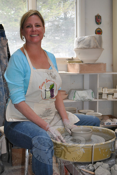 Pottery student Nanci Uliano, of Southbury, throws a bowl on the electric potter's wheel, Saturday, March 5. She is one of 16 students, under the direction of Karen Pinto, who is making bowls to be sold at the Maplewood at Newtown fundraiser in April.  (Crevier photo)