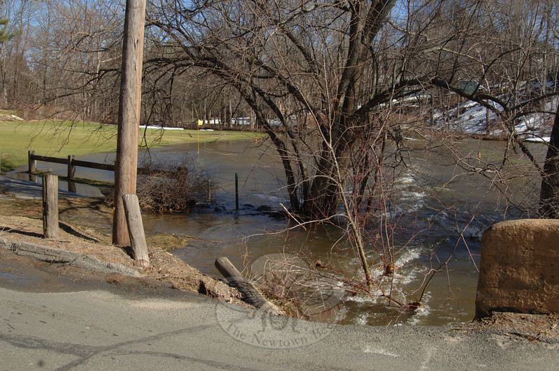 Newtown Country Club was not immune to the overflow of Deep Brook this week. Hole 4, located near the intersection of Brushy Hill Road and Elm Drive, was under a few inches of water on Monday.  (Bobowick photo)