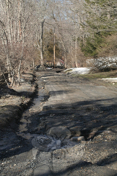 Zoar Road seemed to have escaped major damage following Monday's rain. Vehicles could carefully navigate along this section of the scenic road, near Appleberry Farm.  (Hicks photo)