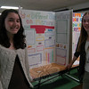 Newtown Middle School students Shelby Tulla, left, and Sarah Lynch presented their project on music and memory Friday, February 25, during a science fair at the school.  (Hallabeck photo)