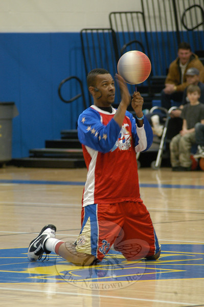 "Harlem Superstar Chris ""Super Chicken"" Turnquist performed a balancing stunt in the Newtown High School gymnasium for the Newtown Underwater Search And Rescue (NUSAR) annual comedy basketball event.  (Hallabeck photo)"